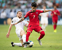CHARLOTTE, NC - JUNE 23: Rolando Abreu #7 and Samuel Piette #6 contest the ball during a game between Cuba and Canada at Bank of America Stadium on June 23, 2019 in Charlotte, North Carolina.