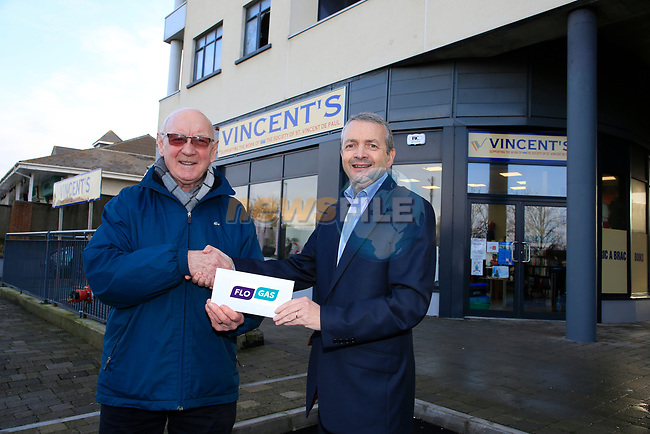 Eoin O'Flynn (R) Marketing manager Flogas Ireland presenting a cheque to Michael Grogan of Vincents outside there new shop premises in Bettystown.<br /> Picture Fran Caffrey | Newsfile