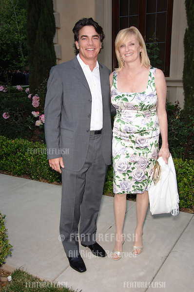 Actor PETER GALLAGHER & wife at Chrysalis' Fifth Annual Butterfly Ball at a private villa in Bel Air. Chrysalis is a non-profit organization dedicated to helping the homeless..June 10, 2006  Los Angeles, CA.© 2006 Paul Smith / Featureflash