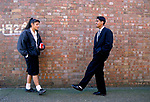 Asian teenage students, boy girl teen emotion love playground Secondary School 1990s UK. Greenford High School, Middlesex  London 1990
