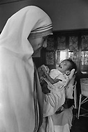 """Calcutta, India. April 04, 1975.<br /> Mother Teresa in her orphanage spending time with each of the children. She spends long hours in the morning talking and confronting them.  Mother Teresa (Agnes Gonxha Boyaxihu) the Roman Catholic, Albanian nun revered as India's """"Saint of the Slums,"""" was awarded the 1979 Nobel Peace Prize."""