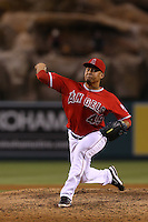 Ernesto Frieri #49 of the Los Angeles Angels pitches against the Boston Red Sox at Angel Stadium on August 30, 2012 in Anaheim, California. Los Angeles defeated Boston 5-2. (Larry Goren/Four Seam Images)