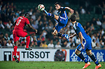 (C) Nicolas Gaitan of Argentina competes for the ball with (L) Fofo Wisdom Agbo during the HKFA Centennial Celebration Match between Hong Kong vs Argentina at the Hong Kong Stadium on 14th October 2014 in Hong Kong, China. Photo by Aitor Alcalde / Power Sport Images