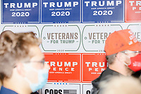 "Trump 2020 campaign signs, including one reading ""Veterans for Trump"" hang on a wall during a Trump campaign office opening party in Salem, New Hampshire, on Fri., Sept. 18, 2020. Former 2016 Trump campaign manager and current 2020 Trump campaign senior advisor Corey Lewandowski, lives in nearby Windham, NH, spoke at the event, which also doubled as a surprise birthday celebration for Lewandowski."