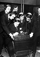Government preparing men for radio work under direction of Federal Vocational Board.  Student transmitting a message to four of his classmates in the class room at the Stuyvesant Evening High School, N.Y.  April 1918.  Ca.  1918.  Western Newspaper Union.  (War Dept.)<br /> Exact Date Shot Unknown<br /> NARA FILE #:  165-WW-113A-5<br /> WAR & CONFLICT BOOK #:  445