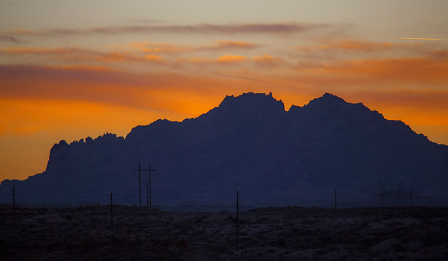 Light from the setting sun shines upon the rugged landscape in Northern Arizona.