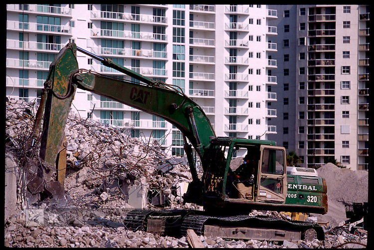 On Miami Beach, Fl May, 2001. A crane clears an old hospital to put up 160 townhouses on an already overcrowded beach.
