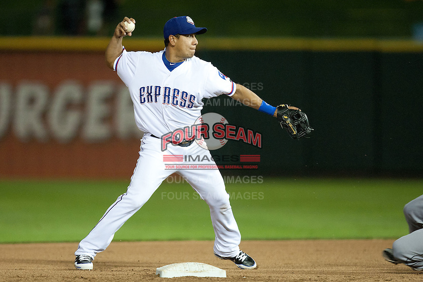 Round Rock Express shortstop Luis Hernandez #9 turns a double play during the Pacific Coast League baseball game against the New Orleans Zephyrs on April 30, 2012 at The Dell Diamond in Round Rock, Texas. The Zephyrs defeated the Express 5-3. (Andrew Woolley / Four Seam Images)