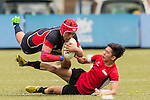 James Karton (l) of Hong Kong battles for the ball during the match between Hong Kong and Singapore of the Asia Rugby U20 Sevens Series 2016 on 12 August 2016 at the King's Park, in Hong Kong, China. Photo by Marcio Machado / Power Sport Images