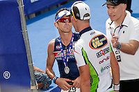 Triathlete Paul Amey is congratulated on his second place by winner Frederik Van Lierde at Ironman France 2012, Nice, France, 24 June 2012.