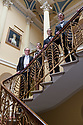 Brocket Hall, Hertfordshire, UK. 16.04.2021. The cast of THE SORROWS OF SATAN, a musical play by Luke Bateman and Michael Conley, pose on the grand staircase of Brocket Hall, where the production is being filmed for streaming. Directed by Adam Lenson, musical direction by Stefan Bednarczyk, produced by Alfred Taylor-Gaunt (Executive Producer) and Aisling Tara (Producer), with lighting design by Sam Waddington and Ben Jacobs, video design by Matt Powell, and costume and set design by Michael Conley. Picture shows: (l to r) Stefan Bednarczyk, Molly Lynch, Luke Bateman, Michael Conley. Photograph © Jane Hobson.