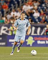 Sporting Kansas City defender Matt Besler (5) brings the ball forward. In a Major League Soccer (MLS) match, Sporting Kansas City defeated the New England Revolution, 1-0, at Gillette Stadium on August 4, 2012.