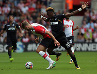 Tammy Abraham of Swansea City (R) challenged by Jack Stephens of Southampton during the Premier League match between Southampton and Swansea City at the St Mary's Stadium, Southampton, England, UK. Saturday 12 August 2017