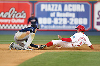 New Hampshire Fisher Cats second baseman Ryan Goins #2 tags out Cesar Hernandez #3 attempting to steal second during a game against the Reading Phillies at FirstEnergy Stadium on April 10, 2012 in Reading, Pennsylvania.  New Hampshire defeated Reading 3-2.  (Mike Janes/Four Seam Images)