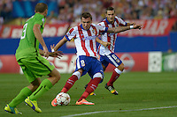 MADRID (SPAIN), OCTOBER, 1, 2014. Mario Mandzukic of Atlético de Madrid fight for the ball with Giorgio Chiellini of Juventus de Turín during the football match of Atlético de Madrid vs Juventus de Turín at Vicente Calderóne stadium for UEFA Champions League. PATRICIO REALPE/ASNERP