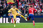 Alex Granell Nogue (L) of Girona FC fights for the ball with Antoine Griezmann of Atletico de Madrid during the La Liga 2017-18 match between Atletico de Madrid and Girona FC at Wanda Metropolitano on 20 January 2018 in Madrid, Spain. Photo by Diego Gonzalez / Power Sport Images
