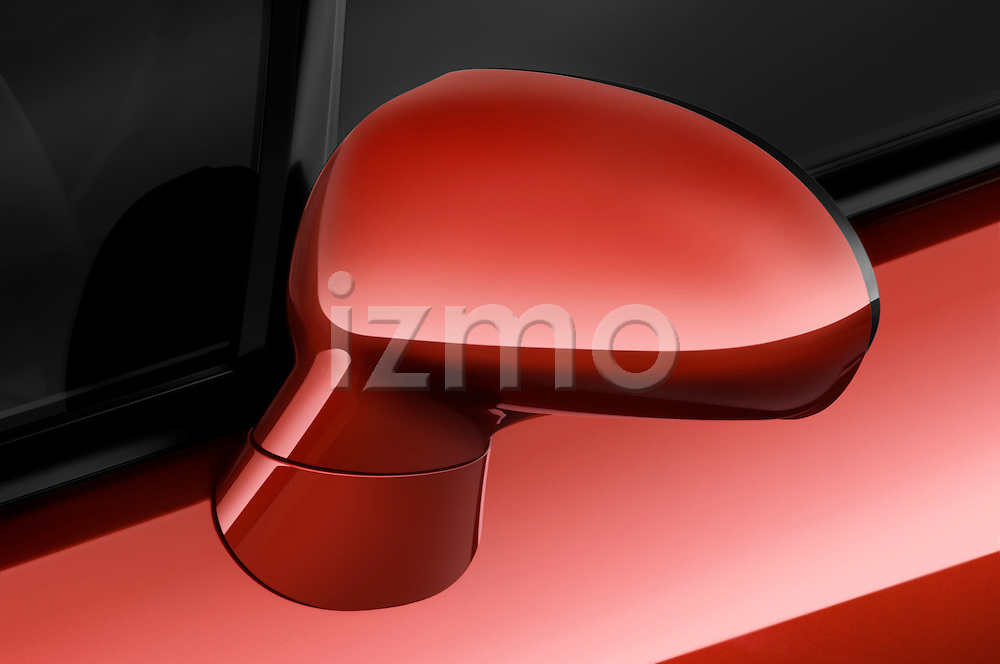 Closeup detail of the side mirror on a 2009 Mitsubishi Eclipse Spyder Convertible Coupe