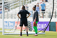 CARY, NC - SEPTEMBER 12: Portland Thorns goalkeeping coach Nadine Angerer speaks with Abby Smith #35 of the Portland Thorns before a game between Portland Thorns FC and North Carolina Courage at WakeMed Soccer Park on September 12, 2021 in Cary, North Carolina.