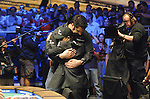 Kahn hugs Yang after being knocked out.