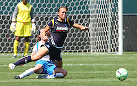 Brittany Bock #11 of the Los Angeles Sol is tripped while chasing a loose ball against the Boston Breakers during thier WPS game at Home Depot Center on May 10, 2009 in Carson, California.
