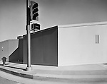 Crowded Vacancy. Century City, Los Angeles 1968 street corner with construction wall and stop light.