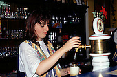 Ostrava, Czech Republic. Barmaid drawing draft beer.