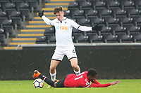 Sunday 18 March 2018<br /> Pictured:  Jack Evans of Swansea City challenges Tosin Kehinde of Manchester United<br /> Re: Swansea City v Manchester United U23s in the Premier League 2 at The Liberty Stadium on March 18, 2018 in Swansea, Wales.
