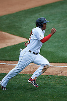 Rochester Red Wings first baseman Reynaldo Rodriguez (23) rounds third to score a run during a game against the Pawtucket Red Sox on July 1, 2015 at Frontier Field in Rochester, New York.  Rochester defeated Pawtucket 8-4.  (Mike Janes/Four Seam Images)