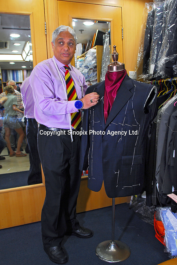Sam poses in Sam's Tailors shop at Nathan road, Hong Kong. He is the founder of Sam's Tailors, one of the best known in Hong Kong. He has dressed presidents, royalty, and even the pope. .04 May 2006