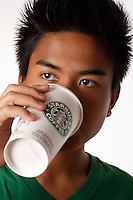 Montreal (Qc) CANADA - August 19 2009 - model released photo - asian (Filipino) male teen drink starbucks coffee