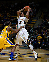 Richard Solomon of California controls the ball away from Mo Hughley of CSUB during the game at Haas Pavilion in Berkeley, California on November 11th, 2012.  California defeated CSUB, 78-65.