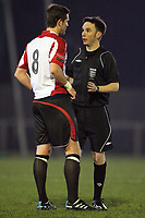 Referee Parker speaks to Frankie Curley - AFC Hornchurch vs Aveley - Ryman League Premier Division Football at The Stadium - 08/03/11 - MANDATORY CREDIT: Gavin Ellis/TGSPHOTO - Self billing applies where appropriate - Tel: 0845 094 6026