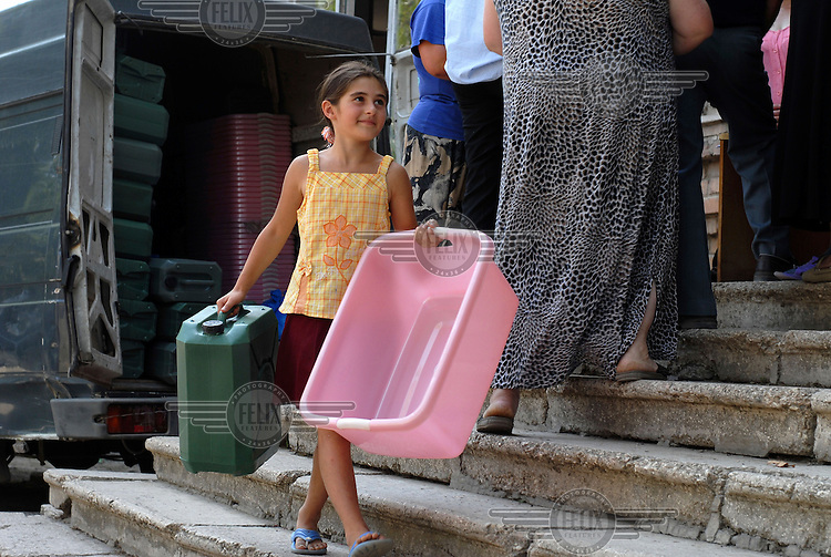Eight year old Keti Mchedlishvili, a young IDP (Internally Displaced Person) from the town of Gori, with some of the NFIs (Non-Food Items) provided by Save the Children at their temporary camp, set up in a commandeered kindergarten.