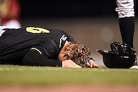 Omaha Storm Chasers outfielder Brian Fletcher (6) on the ground after being injured while diving back to first on a pickoff attempt during the second game of a double header against the Nashville Sounds on May 21, 2014 at Herschel Greer Stadium in Nashville, Tennessee.  Nashville defeated Omaha 13-4.  (Mike Janes/Four Seam Images)