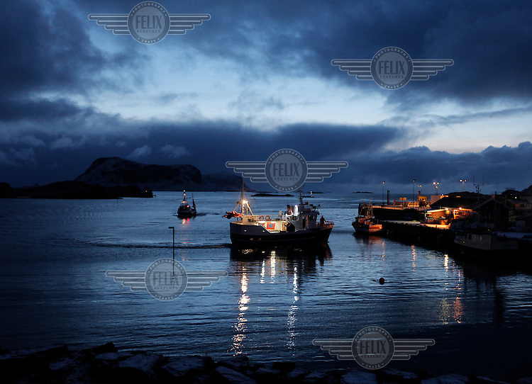 Fishing boats returns with its catch to the island of Røst..The Lofoten is a very important fishing center, especially for the cod (skrei in Norwegian), attracted by the rich food brought by the Gulf Stream.