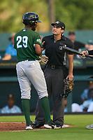Daytona Tortugas Reyny Reyes (29) talks with umpire Joe McCarthy during a game against the Bradenton Marauders on June 12, 2021 at LECOM Park in Bradenton, Florida.  (Mike Janes/Four Seam Images)