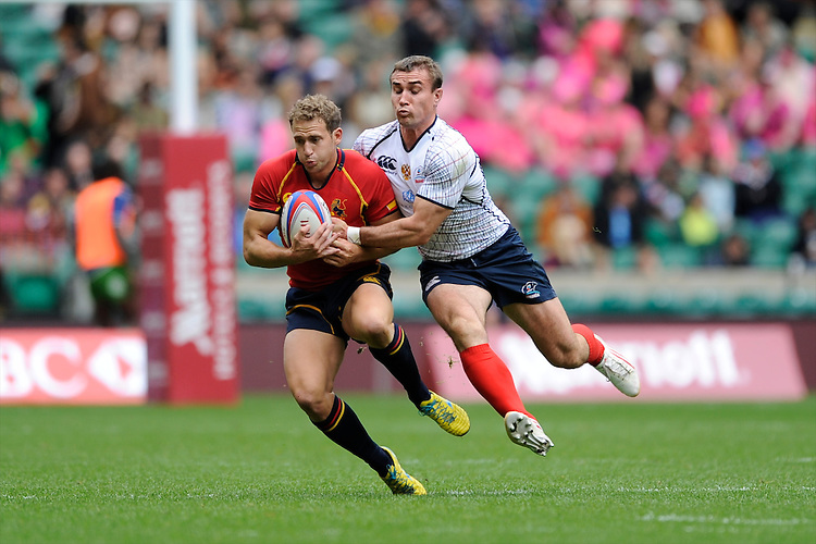 Jaike Carter of Spain is tackled by Vladimir Oustroushko of Russia during the iRB Marriott London Sevens at Twickenham on Saturday 11th May 2013 (Photo by Rob Munro)