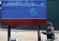 Lew Indorf, with Ken's Signs, installs Monday, February 22, 2021, a new city of Springdale city limits sign on So. Thompson Street in Springdale. Indorf was working on the installation with Joey Weatherly on sign that is equipped with solar panels that eliminated the need for power to be run to sign. Check out nwaonline.com/210223Daily/ and nwadg.com/photos for a photo gallery.<br /> (NWA Democrat-Gazette/David Gottschalk)