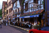 AJ1651, Alsace, outdoor cafe, France, Kaysersberg, Europe, People sitting at an outdoor cafe in the picturesque village of Kaysersberg with its half-timbered houses that line the narrow cobbled streets, a wine growing village of Alsace, France.