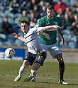 Raith Rovers' Lewis Vaughan holds off Hib's Liam Fontaine.