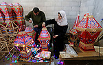 Palestinian Khaled Sweidan,44, and his wife Ghadeer Zindah,40, make lanterns for sale in their home in preparation for the Muslim holy month of Ramadan, amid the coronavirus disease (COVID-19), in Khan Younis in the southern of Gaza Strip on March 25, 2021. The Israeli siege and deteriorating economic conditions push Khaled and Ghadeer spouses to make Ramadan decorations and lanterns inside their home to support members of their family of 3 children. Photo by Ashraf Amra