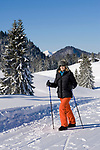 Deutschland, Bayern, Chiemgau - Reit im Winkl: Paradies fuer Langlaeufer und Spaziergaenger auf der Winklmoosalm - Frau beim Nordic Walking | Germany, Bavaria, Chiemgau - Reit im Winkl: cross country ski run and hiking trail at Winklmoosalm - woman Nordic Walking
