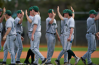 Dartmouth Big Green celebrate closing out a game against the Omaha Mavericks on February 23, 2020 at North Charlotte Regional Park in Port Charlotte, Florida.  Dartmouth defeated Omaha 8-1.  (Mike Janes/Four Seam Images)