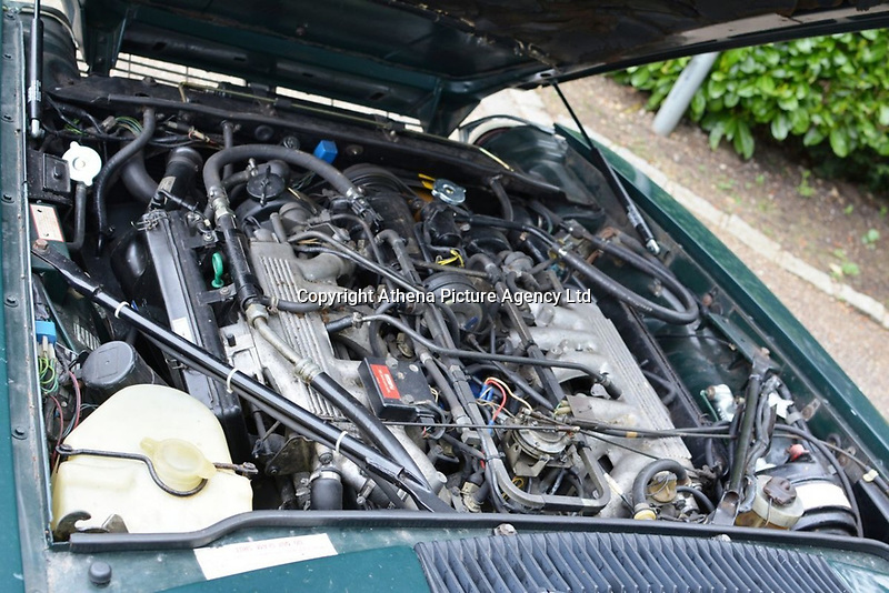 "Pictured: The engine bay of the Jaguar up for auction, once owned by Eamonn Holmes<br /> Re: A luxury open-top car sold by TV's Eamonn Holmes to pay off his ""massive"" tax bill is up for grabs at auction.<br /> The host of Good Morning Britain bought the 5.3 litre Jaguar when he was earning big bucks with the BBC.<br /> But Eamonn was made redundant and at the same time he was hit with an £11,000 demand from the Inland Revenue.<br /> The car was costing him a fortune to run - it did under 15mpg.<br /> After paying a whopping £36,000 for the Jaguar XJSC, Eamonn flogged it for just £8,000 a year later.<br /> The car has an identical price tag at auction almost 30 years later.    <br /> Eamonn, 57, told how he got shot of the Jag when the 1990 Gulf War sparked a big hike in fuel prices.<br /> He said: ""Cars are my weakness - in 1989 I bought a British Racing Green Jaguar.<br /> ""I paid £36,000 in March 1989 then in early 1990 the Gulf War broke out."