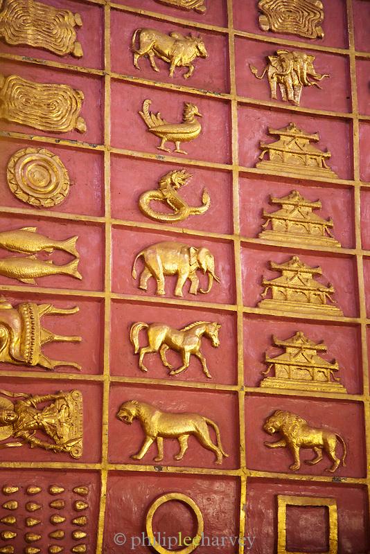 Animal symbols and engravings in Chaukhtatgyi Temple, a buddhist temple in Yangon (Rangoon), Myanmar
