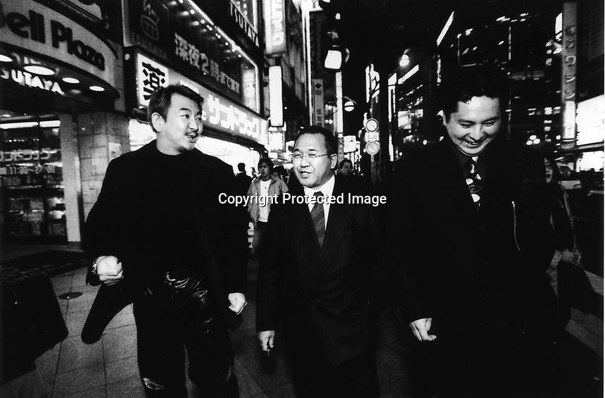 Former Yakuza, Japanese gangstars, became Christian missionaries walking in the street of Kabukicho, Shinjuku, Tokyo, Japan