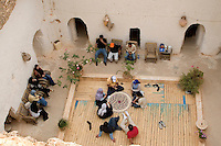 Gharyan, Libya - Looking down into Troglodyte House from Ground Level. Family Playing Cards.