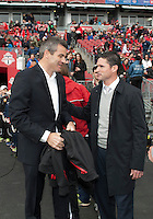 Toronto, Ontario - May 3, 2014: New England Revolution head coach Jay Heaps greets Toronto FC head coach Ryan Nelsen during the opening ceremonies in a game between the New England Revolution and Toronto FC at BMO Field.<br /> The New England Revolution won 2-1.