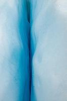 Close up of blue ice crevasse on Franz Josef Glacier, Westland NP, West Coast, New Zealand