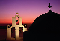Church dome and belfry at sunset Santorini Greece